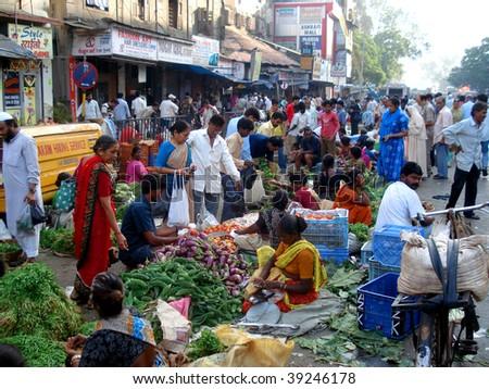 MUMBAI - NOVEMBER 2: Fruit and vegetable sellers on the streets of Mumbai just weeks before the bomb attack on Taj Mahal Palace Hotel November 2, 2008 in Mumbai, India. - stock photo