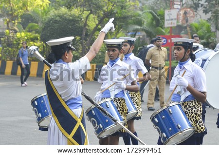 MUMBIA, INDIA - JAN 24, 2014 - Students parading near Marine Drive  during the rehearsal on 24 January 2014 for India's Republic Day to be held on 26 January 2014  - stock photo