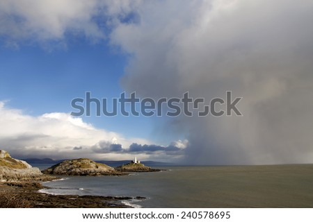 Mumbles lighthouse, Swansea with approaching storm - stock photo