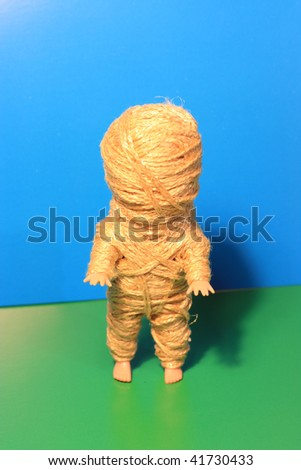 Mummy a doll. Shake with ropes. - stock photo