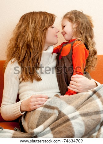 mummy and her daughter in  home - stock photo