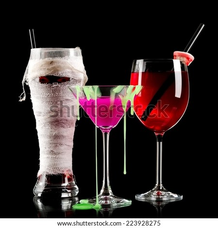 Mummy, bloody and pink Halloween cocktails - stock photo