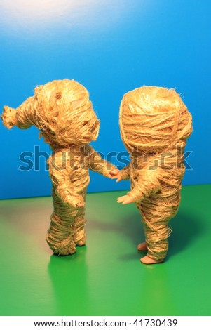 Mummy dolls couple. Shake with ropes. - stock photo
