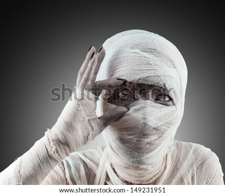 Mummy opens her eyes to see you and invite to a party Halloween - stock photo