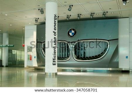 MUNCHEN, GERMANY - 25 MAY, 2010: Huge radiator grill of an electric BMW car as an advertising for electric care development as seen in Munich Airport on May 25. - stock photo