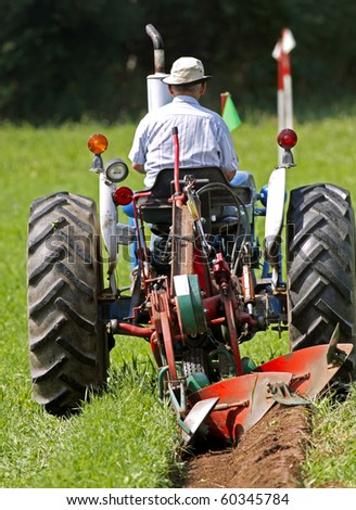 MUNDLEVILLE, CANADA - AUGUST 31: A competitor begins his plot at the 2010 New Brunswick Provincial Plowing Match and Canadian Plowing Championships on August 31, 2010 in Mundleville, Canada. - stock photo