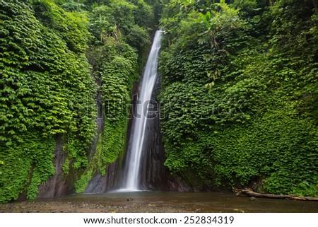 Munduk waterfall in bali - stock photo