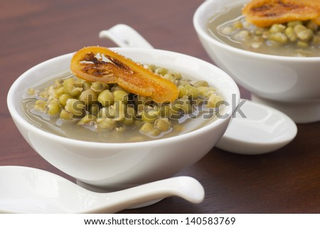 Mung Bean Broth with Candied Orange Garnish. Non sharpen file - stock photo