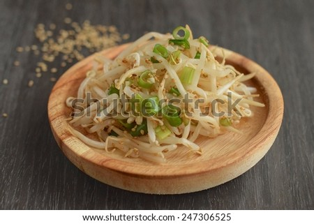 Mung bean sprouts salad with sesame seeds and spring onion - stock photo