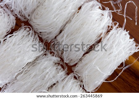 Mung bean vermicelli or cellophane noodles, a transparent thread-like noodle made from dried mung bean paste for use in traditional Asian cuisine - stock photo