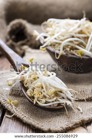 Mungbean Sprouts (close-up shot) on wooden background - stock photo