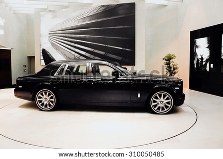 MUNICH, BAVARIA, GERMANY - JULY 1, 2015: Rolls-Royce at the BMW Welt in Munich, Germany. Black and white background - stock photo