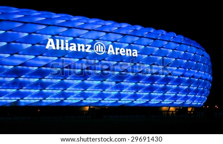 MUNICH – CIRCA SEPT 2008 : Colorful illumination of Allianz Arena, FIFA 2006 World Cup Stadium circa September 2008 in Munich. The stadium has nicknames such as UFO, rubber dinghy, and lifebelt. - stock photo