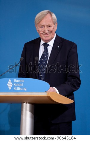 MUNICH - DECEMBER 10: Hans Zehetmair (Chairman of the Hanns Seidel Foundation and Ex Minister of State of Bavaria) speaks at the Award for the Franz-Josef Strauss Prize for Mikhail Gorbachev in Munich, Germany on December 10, 2011. - stock photo