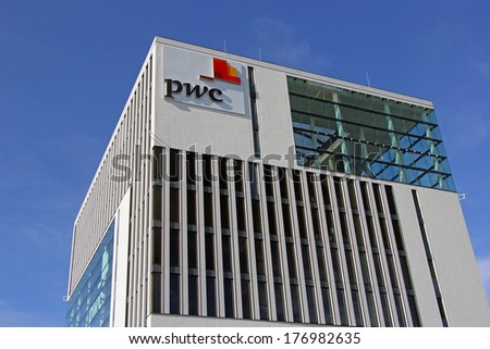 MUNICH - FEBRUARY 15: The logo of Price Waterhouse Coopers - one of the largest professional services companies - is displayed on a modern office building in Munich, Germany on February 15th, 2014.
