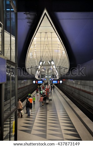 Munich, Germany - April 22, 2014: Interior of Hasenbergl underground station in Munich. Curve Futuristic design with lighting on a blue background. - stock photo