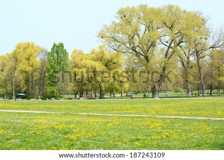 MUNICH, GERMANY - APRIL 12, 2014:  Locals enjoy the English Garden in Munich as Springtime weather arrives in Germany. - stock photo