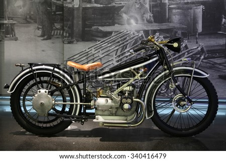 MUNICH, GERMANY - APRIL 27, 2013: Vintage branding BMW motorcycle in BMW Museum in Munich, Germany