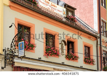 MUNICH, GERMANY - AUGUST 3, 2015: Augustiner Braeu sign near the Dom - A 670-year-old brewery & tavern founded on the site of a monastery known for it's Oktoberfest beers. - stock photo