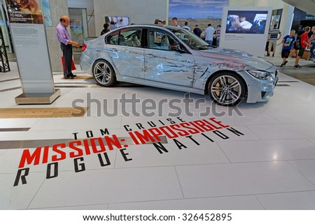 MUNICH, GERMANY - 4 AUGUST 2015: The original BMW M3 used in the film set of Mission: Impossible, Rogue Nation, starring Tom Cruise. BMW World showroom in Munich, Germany. - stock photo