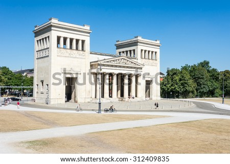 MUNICH, GERMANY - AUGUST 3: Tourits at the Koenigsplatz in Munich, Germany on August 3, 2015. During the third reich the square was used for Nazi parties.  - stock photo