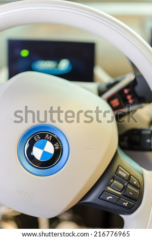 MUNICH, GERMANY - AUGUST 8, 2014: White design interior of environmentally friendly full-time electric car BMW i3. Vertical close-up photo with small DOF. - stock photo
