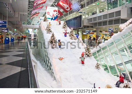 MUNICH, GERMANY - DECEMBER 24, 2009: Christmas decorations at Munich airport in Germany. Ski resort, gnomes skiing between Christmas trees. Munich Airport It is the second busiest airport in Germany.