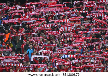 MUNICH, GERMANY - DECEMBER 12 2015: Fans during the Bundesliga match between Bayern Muenchen and FC Ingolstadt, on December 12, 2015 in Munich, Germany.  - stock photo