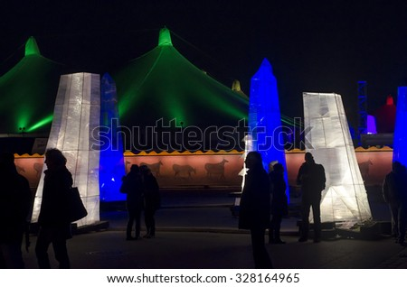 Munich, Germany -DECEMBER 11: Outside of Tollywood Festival in night scene with people and sculptures of light on December 11.2011 in Munich, Germany as editorial - stock photo