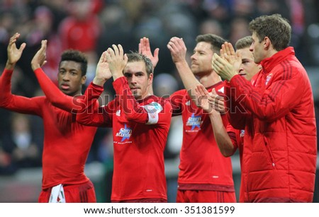 MUNICH, GERMANY - DECEMBER 12 2015: Philipp Lahm of Bayern Munich leads the team applauding fans at the Bundesliga match between Bayern Muenchen and FC Ingolstadt, on December 12, 2015  - stock photo