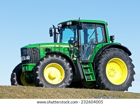 MUNICH, GERMANY - FEBRUARY 29 - A John Deere Model 6630 - new tractor at a field  at February 29, 2012 near munich - germany