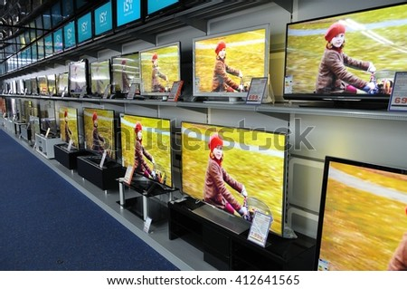 MUNICH, GERMANY - JANUARY 19, 2013: Wall of flat screen televisions in the electronics section of store