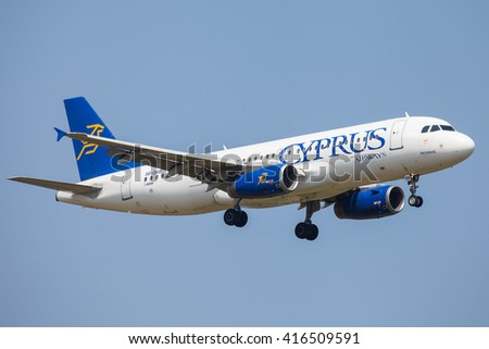 MUNICH, GERMANY - JULY 07, 2013: Airplane at Munich Airport named Franz Josef Strauss. Cyprus Airlines Airbus A320 is landing