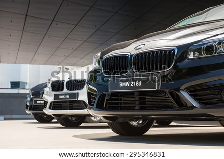 MUNICH, GERMANY - JULY 1, 2015: BMW 218d at the BMW Welt, a customer experience and exhibition facility of the BMW AG, Munich, Germany - stock photo