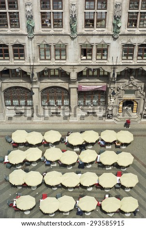 MUNICH, GERMANY - JUNE 3, 2015: Beautiful Weather Brings out  Diners at the City Hall  Restaurant on the Marienplatz in Munich, Germany. - stock photo