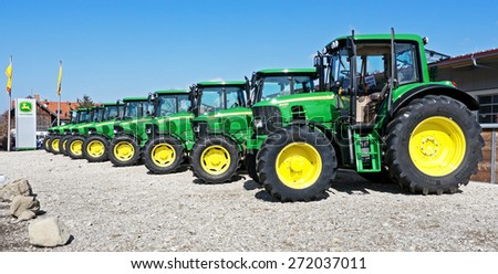 MUNICH, GERMANY - MARCH 20 - John Deere Model 6430 - new tractors at a front yard at March 20, 2012 near munich - germany - stock photo