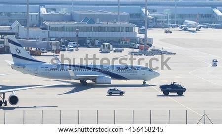 Munich, Germany - May 6, 2016: Armed police armored vehicle ensures antiterrorism attack defense measures for Israeli El-Al airliner in Munich internetional passenger airport. - stock photo
