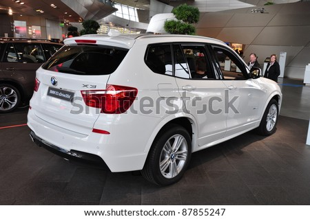 MUNICH, GERMANY - OCTOBER 31: BMW Motor Show on October 31, 2011 in BMW Welt in Munich, new BMW X3 - stock photo
