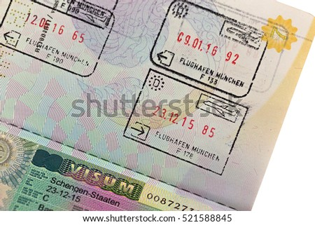 MUNICH, GERMANY - OCTOBER 2016 : Schengen visa with arrival and departure entry stamp on Thai passport for immigration traveling at Munich airport, Germany on October 23, 2016.  Shallow Depth of Field