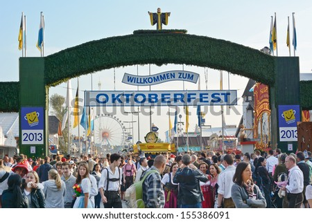 MUNICH, GERMANY - SEPT. 21, 2013: Crowds of visitors at the annual Oktoberfest celebrating the opening day.   The Festival runs from Sept. 21 - Oct. 6  in Munich, Germany - stock photo