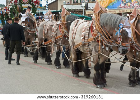 MUNICH, GERMANY - SEPT. 20, 2015: Spatenbrau Beer Carriage Entertaining Crowds at the annual Okotoberfest. The Festival runs from September 19th until October 4th 2015 in Munich, Germany - stock photo