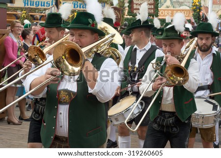 MUNICH, GERMANY - SEPT. 20, 2015: Traditional Marching Bands entertain Crowds of visitors at the annual Oktoberfest. The Festival runs from September 19th until October 4th 2015 in Munich, Germany - stock photo