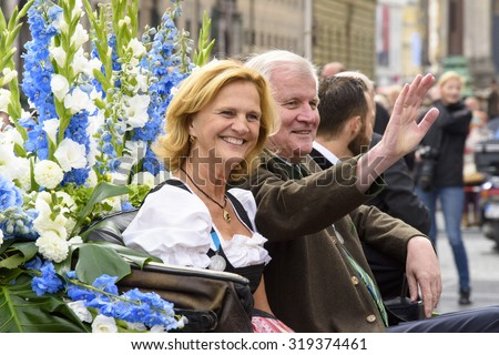 MUNICH, GERMANY - SEPTEMBER 20, 2015: Bavarian prime minister Horst Seehofer and his wife Karin were guests at the opening parade of the famous Oktoberfest, the biggest beer festival of the world - stock photo