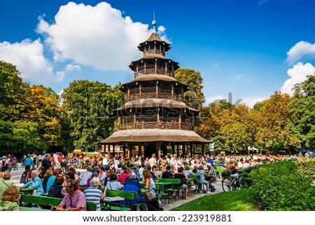 MUNICH, GERMANY - SEPTEMBER 07, 2014: Biergarten near Chinese tower in English garden on September 07, 2014 in Munich, Bayern, Germany. - stock photo