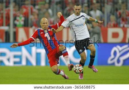 MUNICH, GERMANY - SEPTEMBER 23 2014: During the Bundesliga match between Bayern Muenchen and FC Paderborn, in the Allianz Arena, Munich, Germany.  - stock photo