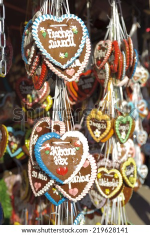 MUNICH, GERMANY - SEPTEMBER 23, 2014: The Oktoberfest in Munich is the biggest beer festival of the world with shops for sweets and hearts of gingerbread. - stock photo