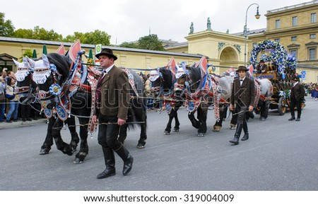 MUNICH, GERMANY - SEPTEMBER 20, 2015: The Oktoberfest is the world biggest beer festival and at the opening parade with rd. 9000 participants take part in historical costumes, music bands and horses.
