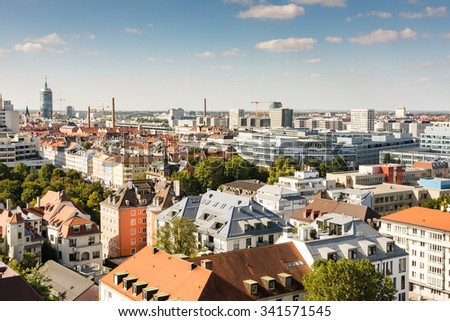 MUNICH, GERMANY - SEPTEMBER 30: View over Munich, Germany on September 30, 2015. Munich is the biggest city of Bavaria with almost 100 million visitors a year. Foto taken from the tower of St. Paul. - stock photo