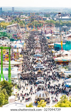 MUNICH, GERMANY - SEPTEMBER 30: View over the Oktoberfest in Munich, Germany on September 30, 2015. The Oktoberfest is the biggest beer festival of the world with over 6 million visitors each year.  - stock photo