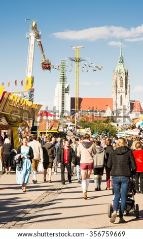 MUNICH, GERMANY - SEPTEMBER 30: Visitors of the Oktoberfest in Munich, Germany on September 30, 2015. The Oktoberfest is the biggest beer festival of the world with over 6 million visitors each year. - stock photo